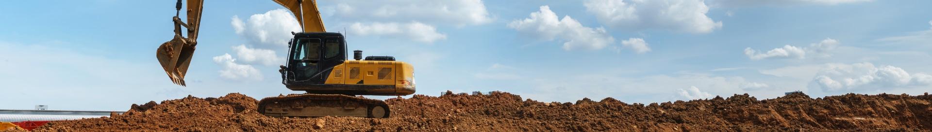 Tractor digging dirt